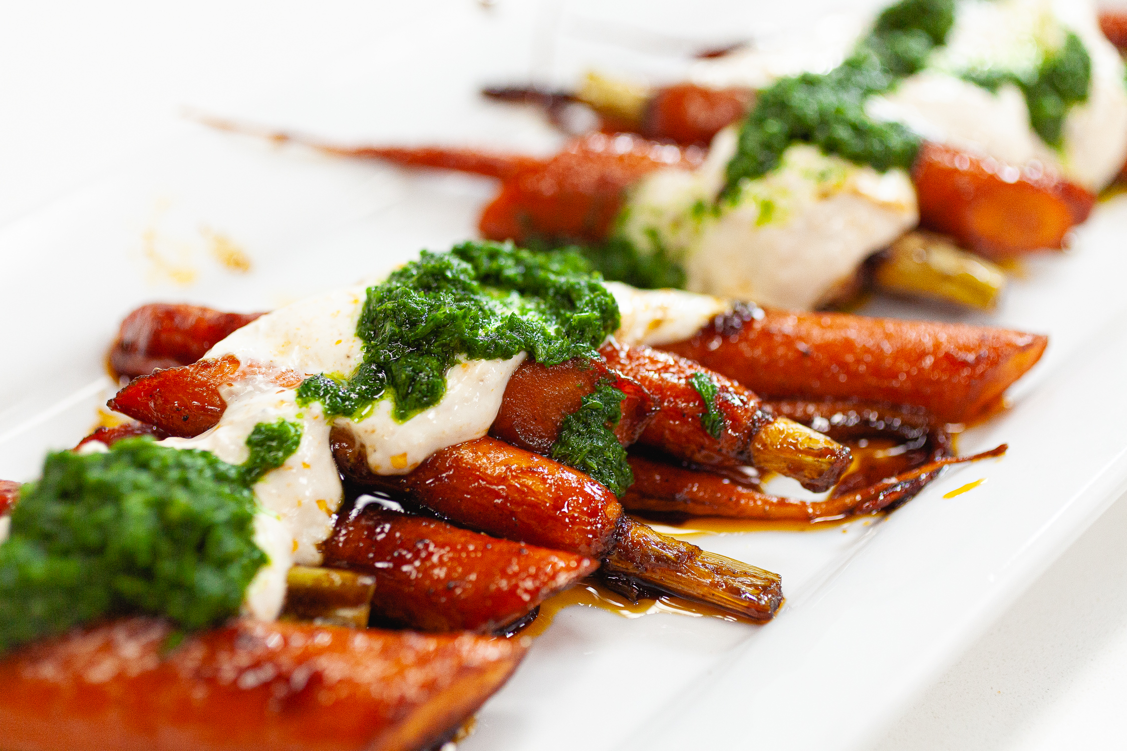 Barbecue smoked carrots with cool yogurt and herbaceous parsley pesto!